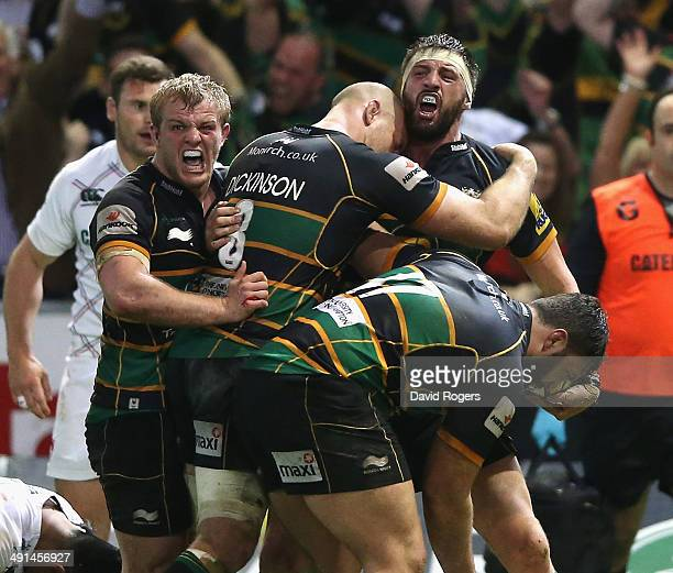 Tom Wood of Northampton Saints celebrates with team mates after scoring the last minute match winning try during the Aviva Premiership semi final...