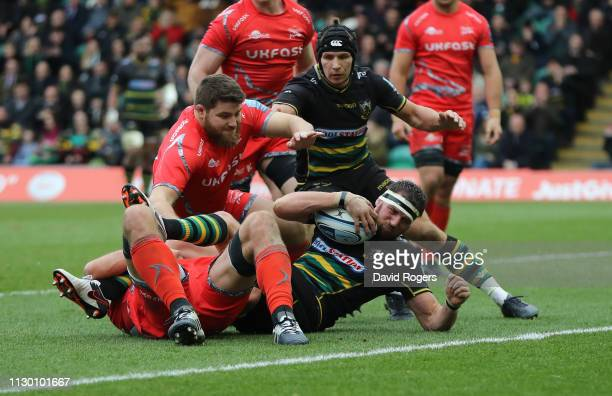 Tom Wood of Northampton Saints dives over for their third try during the Gallagher Premiership Rugby match between Northampton Saints and Sale Sharks...