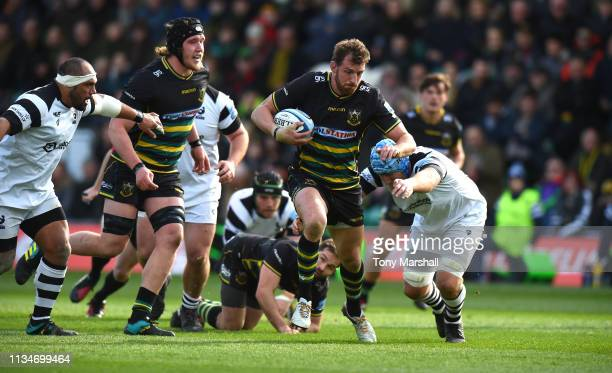 Tom Wood of Northampton Saints is tackled by Jordan Crane of Bristol Bears during the Gallagher Premiership Rugby match between Northampton Saints...