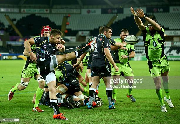 Tom Wood of Saints blocks a clearance from Rhys Webb of Osprays that leads to the first Saints try during the European Rugby Champions Cup match...