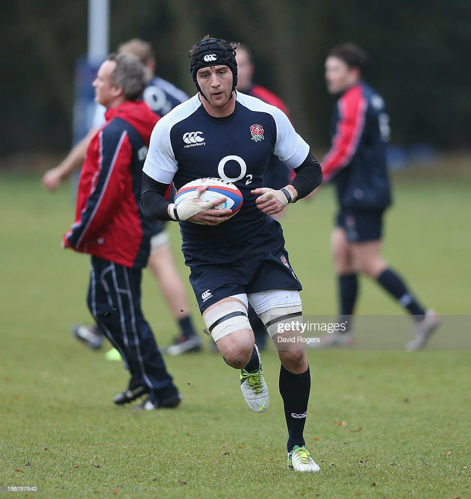 Tom Wood runs with the ball during the England training session held at Pennyhill Park on November 20, 2012 in Bagshot, England.