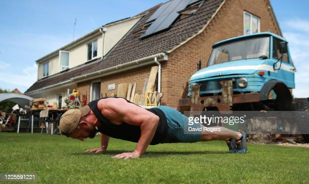 Tom Wood, the Northampton Saints and England back row forward, does pushups as he works out in his garden on May 18, 2020 in Northampton, United...