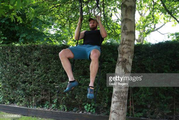 Tom Wood, the Northampton Saints and England back row forward, performs pull ups as he works out in his garden on May 18, 2020 in Northampton, United...