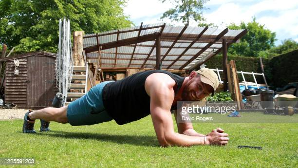 Tom Wood, the Northampton Saints and England back row forward, performs the plank, as he works out in his garden on May 18, 2020 in Northampton,...