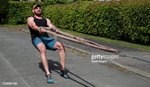 Tom Wood, the Northampton Saints and England back row forward, pulls his four wheel drive vehicle as he works out on May 18, 2020 in Northampton,...