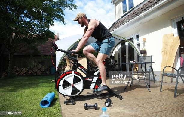 Tom Wood, the Northampton Saints and England back row forward, works out in his gardenusing a Wattbike on May 18, 2020 in Northampton, United Kingdom.