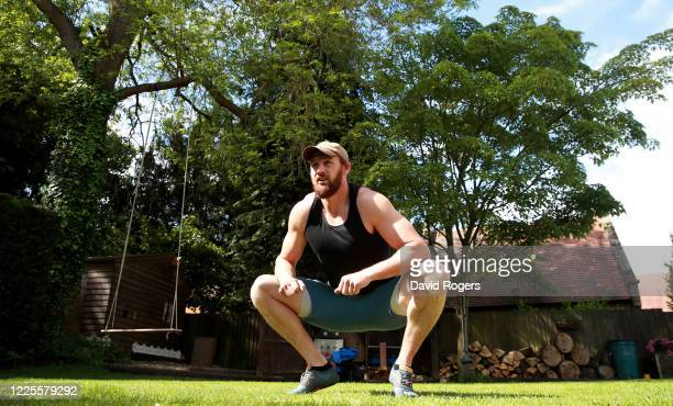 Tom Wood, the Northampton Saints and England back row forward, works out in his garden on May 18, 2020 in Northampton, United Kingdom.