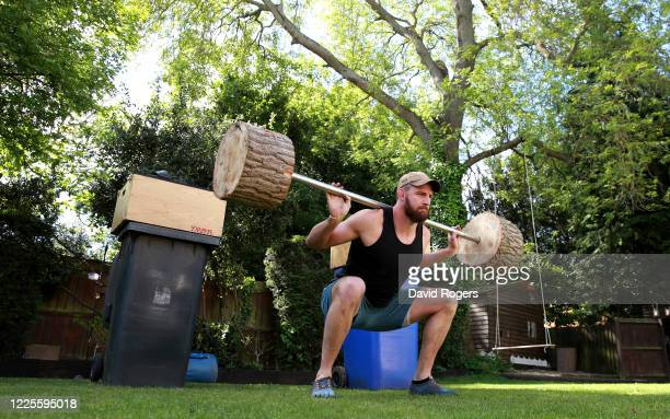 Tom Wood, the Northampton Saints and England back row forward, works out in his back garden using a home made barbell on May 18, 2020 in Northampton,...