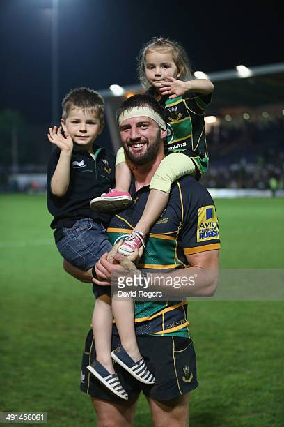Tom Wood, who scored the match winning try for Northampton Saints celebrates with his children Oliver and Isabella on their victory lap during the...