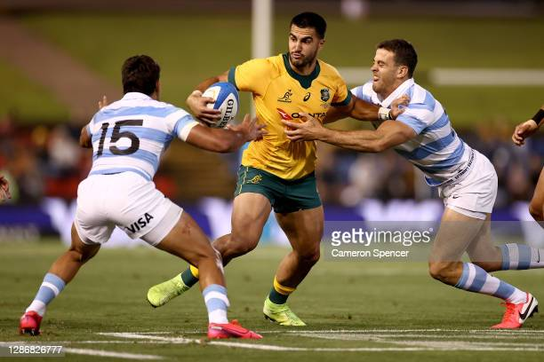 Tom Wright of Australia is tackled during the 2020 Tri-Nations match between the Australian Wallabies and the Argentina Pumas at McDonald Jones...
