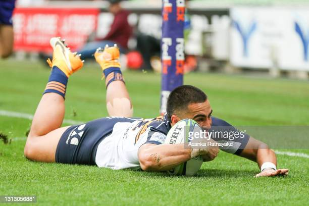 Tom Wright of the Brumbies scores a try during the round nine Super Rugby AU match between the ACT Brumbies and the Melbourne Rebels at AAMI Park, on...