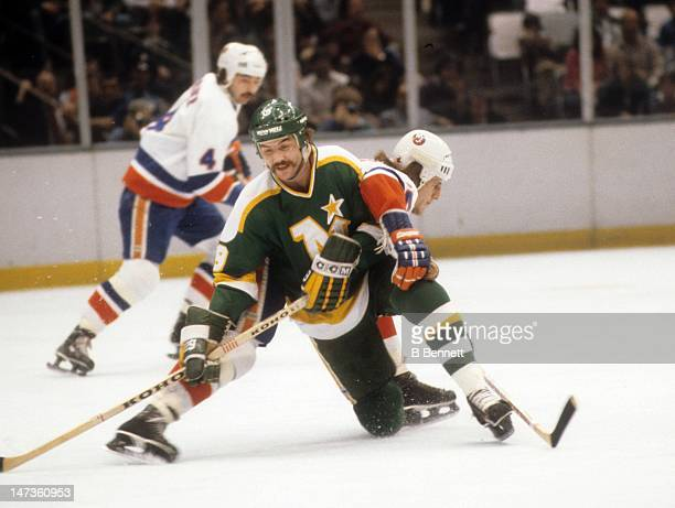Tom Younghans of the Minnesota North Stars battles with Mike Bossy of the New York Islanders on February 21 1980 at the Nassau Coliseum in Uniondale...