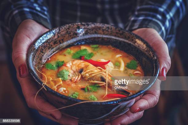tom yum goong nam kon thai soup with shrimps, enoki mushrooms and fresh chili - thai food stock pictures, royalty-free photos & images