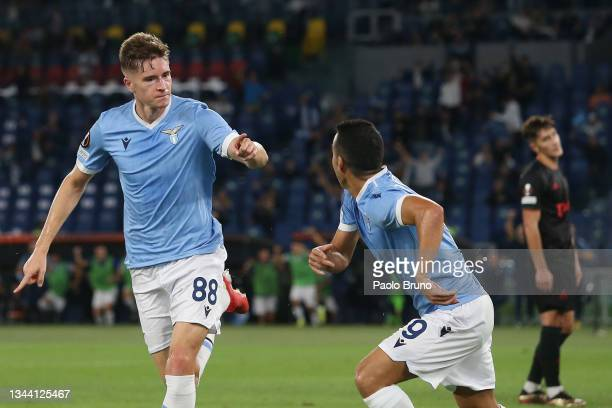 Toma Basic of SS Lazio celebrates with team mate Pedro after scoring their sides first goal during the UEFA Europa League group E match between SS...