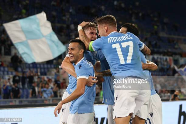 Toma Basic of SS Lazio celebrates with team mate Pedro and Ciro Immobile after scoring their sides first goal during the UEFA Europa League group E...
