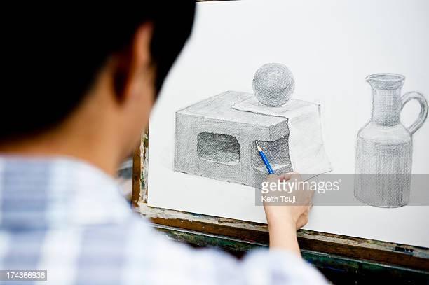Toma Takeda draws a figure on July 17 2013 in Yokohama Japan Selftaught origami artist Toma Takeda was diagnosed with Moyamoya disease and had...