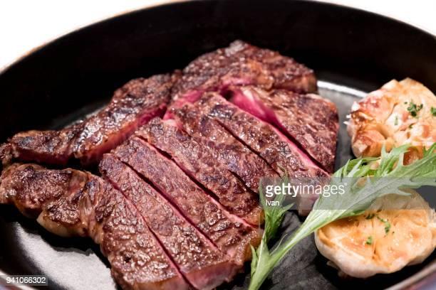 Tomahawk beef steak with garlic