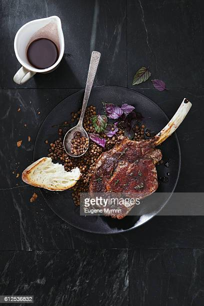 Tomahawk beef steak with lentil