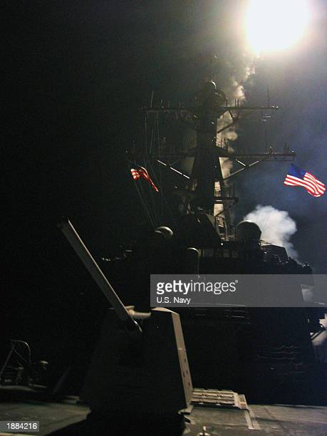Tomahawk land attack missile's booster lights up the deck of USS Winston S Churchill on March 29 2003 in the Mediterranean Sea The USS Winston S...