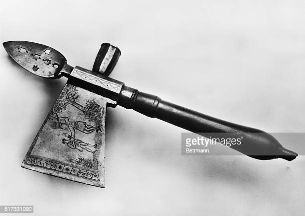 Tomahawk with engravings Eastern woodlands Indians of North America Note blade illustration of Indian making good use of the tomahawk Ca 18th century...