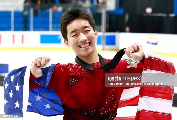 Tomaki Hiwatashi of the USA shows off his silver medal after finishing second in the junior mens free skating program during the 2018 Junior Grand...