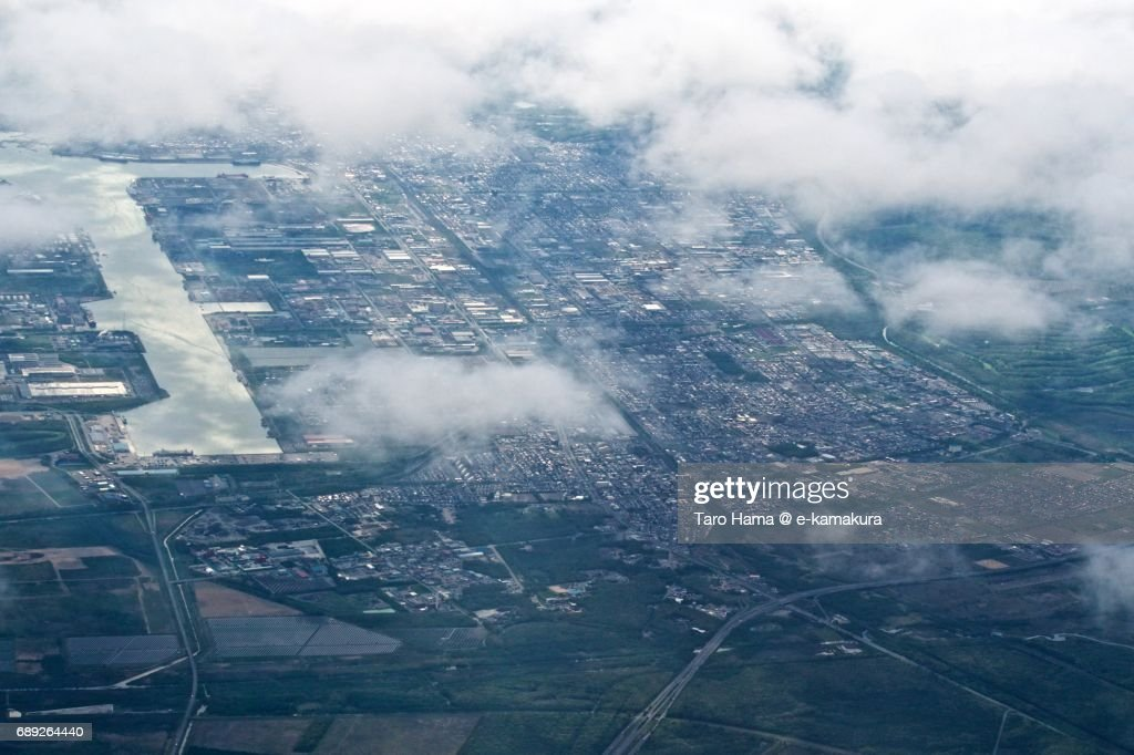 Tomakomai city in Hokkaido daytime aerial view from airplane : Stock Photo
