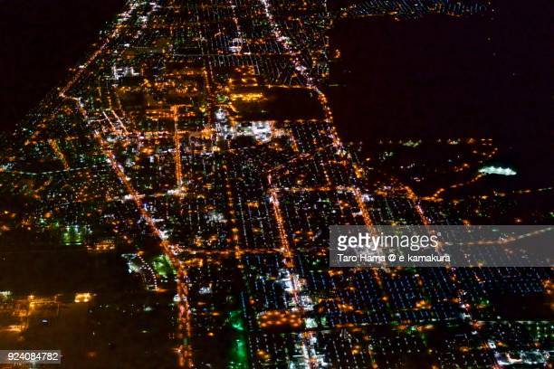 Tomakomai city in Hokkaido in Japan night time aerial view from airplane
