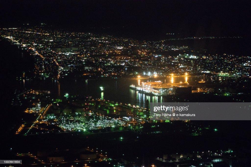 Tomakomai city in Hokkaido night time aerial view from airplane : Stock Photo