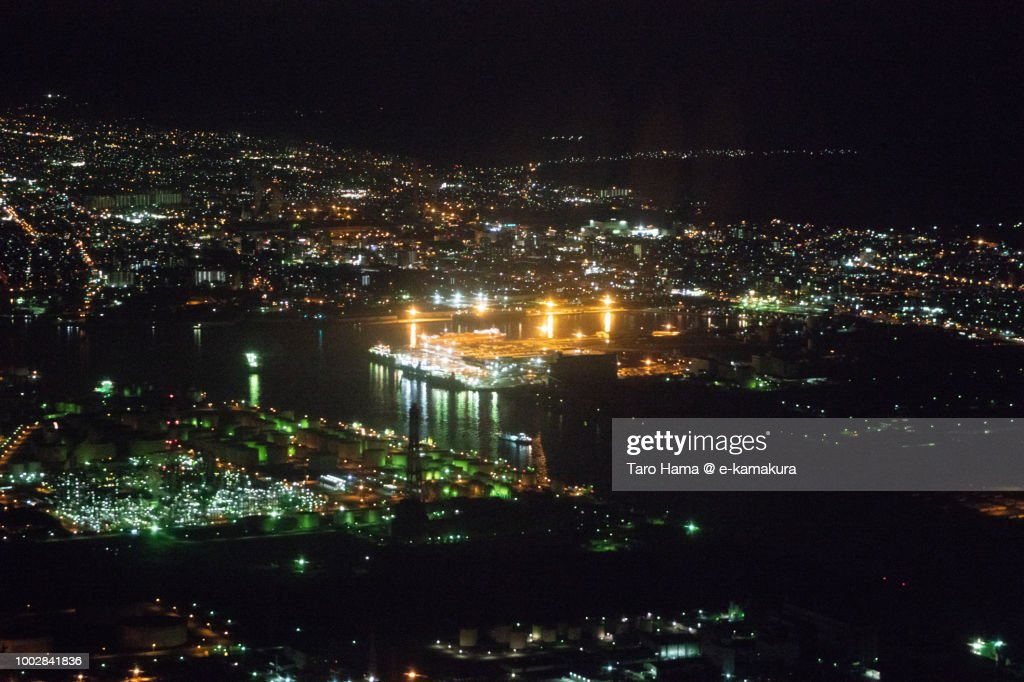 Tomakomai city in Hokkaido night time aerial view from airplane : Stock Photo
