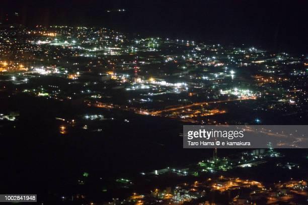 Tomakomai city in Hokkaido night time aerial view from airplane