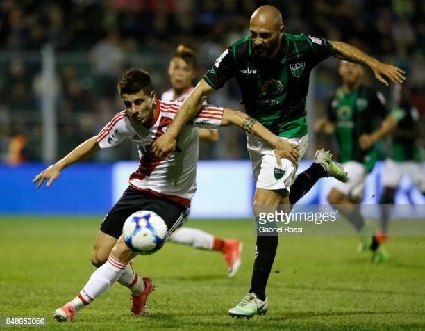 Tomas Andrade of River Plate fights for the ball with Gonzalo Prosperi of San Martin during a match between San Martin de San Juan and River Plate as...