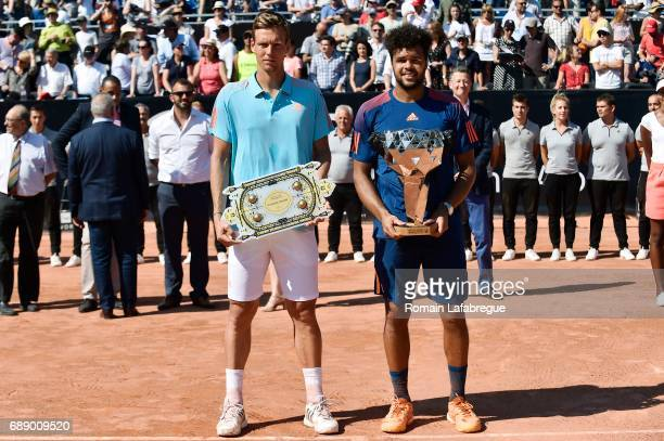 Tomas Berdych of Czech Republic and Jo Wilfried Tsonga of France celebrates winning the Final of Open Parc of Lyon 2017 on May 27 2017 in Lyon France