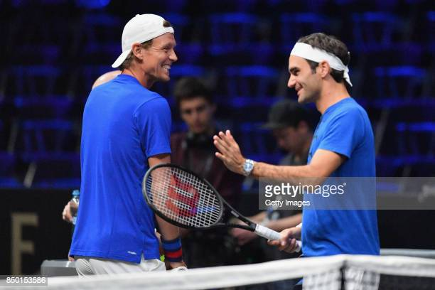Tomas Berdych of Czech Republic and Roger Federer of Switzerland share a joke during a training session ahead of the Laver Cup on September 20 2017...