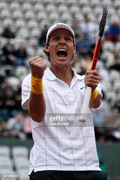 Tomas Berdych of Czech Republic celebrates match point during the men's singles fourth round match between Andy Murray of Great Britain and Tomas...