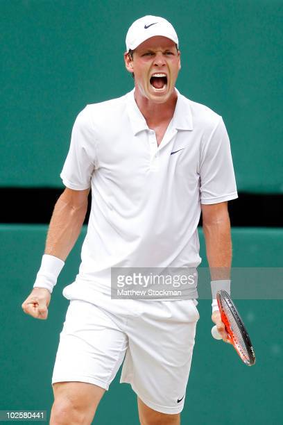 Tomas Berdych of Czech Republic celebrates taking the second set during the Men�s Semi Final match against Novak Djokovic of Serbia on Day Eleven of...