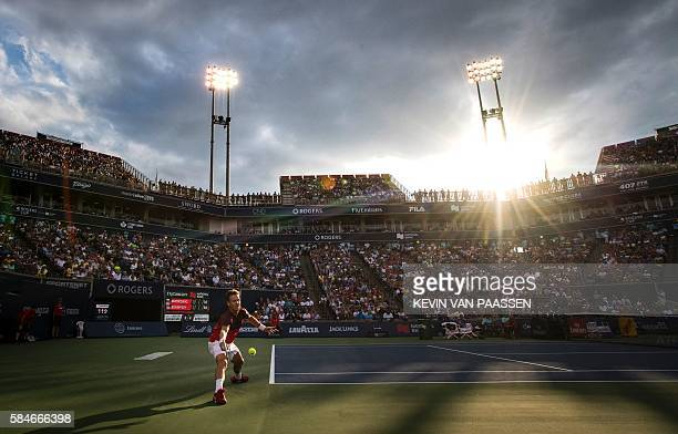 TOPSHOT Tomas Berdych of Czech Republic competes against Novak Djokovic of Serbia during quarter final action at the Rogers Cup in Toronto Canada...