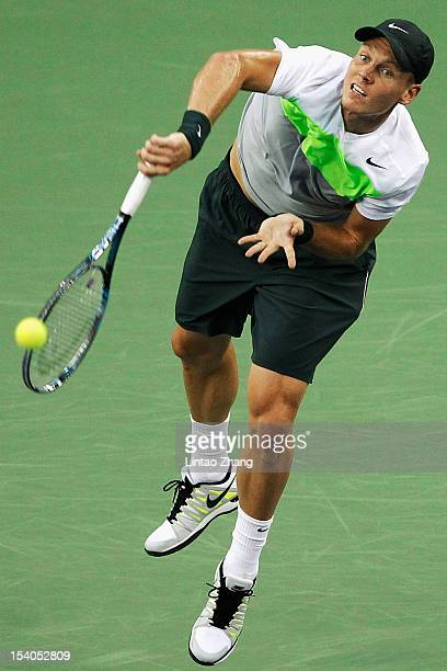 Tomas Berdych of Czech Republic hits a serve to Novak Djokovic of Serbia during the Men's Single Semifinal of the Shanghai Rolex Masters at the Qi...