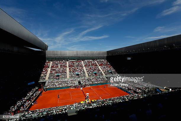 Tomas Berdych of Czech Republic in action against Rafael Nadal of Spain in the semi finals during day eight of the Mutua Madrid Open tennis...