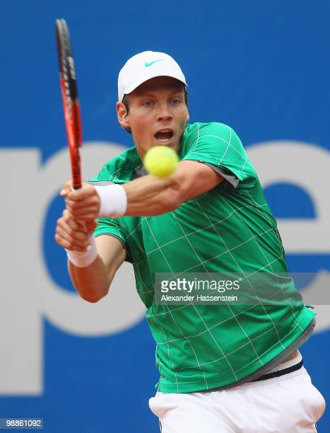 Tomas Berdych of Czech Republic plays a backhand during his match against Pere Riba of Spain at day 4 of the BMW Open at the Iphitos tennis club on...