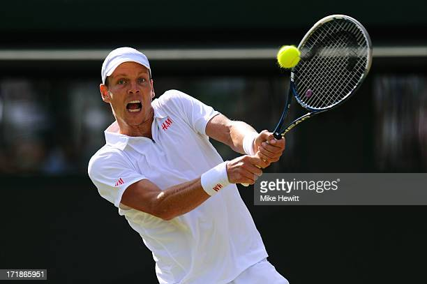 Tomas Berdych of Czech Republic plays a backhand during the Gentlemen's Singles third round match against Kevin Anderson of South Africa on day six...