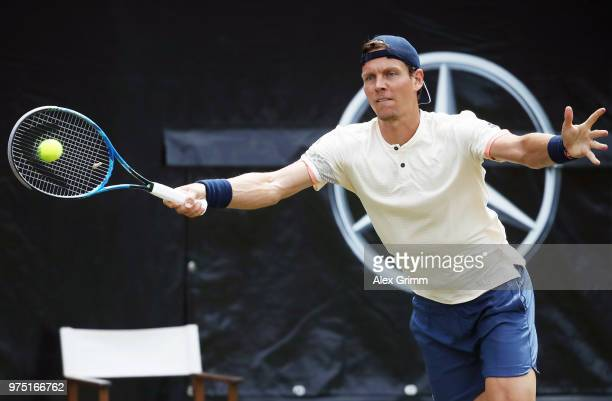 Tomas Berdych of Czech Republic returns the ball to Milos Raonic of Canada during day 5 of the Mercedes Cup at Tennisclub Weissenhof on June 15 2018...