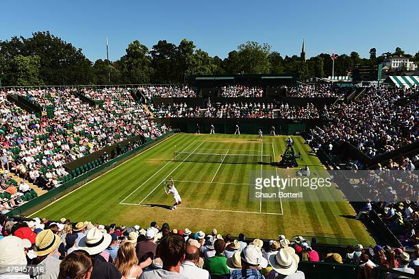 Tomas Berdych of Czech Republic serves in his Mens Singles Third Round match against Pablo Andujar of Spain during day six of the Wimbledon Lawn...
