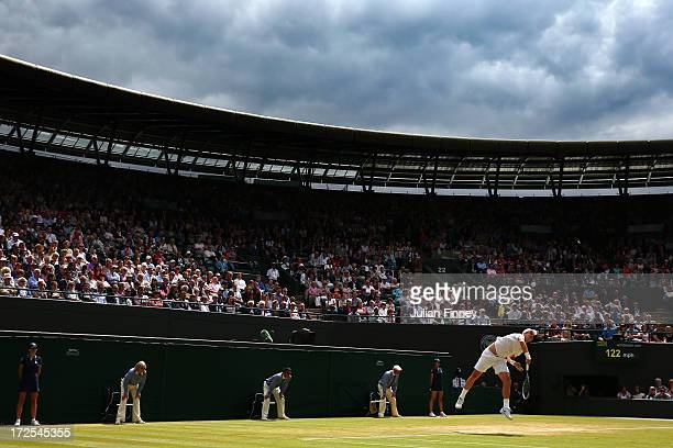 Tomas Berdych of Czech Republic serves on Court One during the Gentlemen's Singles quarterfinal match against Novak Djokovic of Serbia on day nine of...