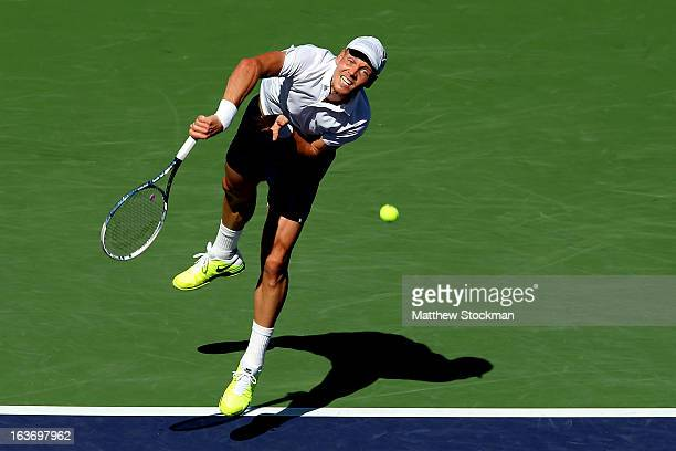 Tomas Berdych of Czech Republic serves to Kevin Anderson of South Africa during the BNP Paribas Open at the Indian Wells Tennis Garden on March 14,...
