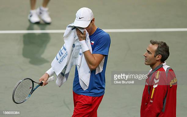 Tomas Berdych of Czech Republic shows his dejection watched by Spain's team captain Alex Corretja during his straight sets defeat by David Ferrer of...