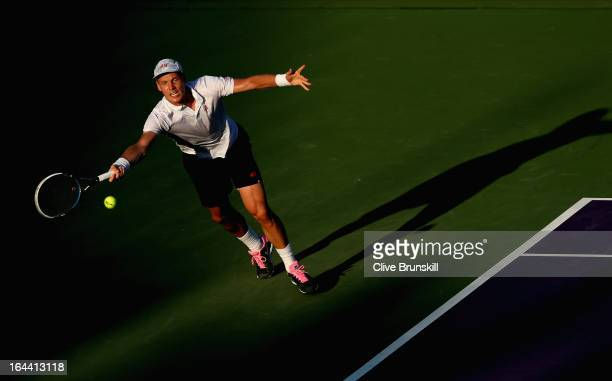 Tomas Berdych of Czech Republic stretches to play a forehand against Daniel GimenoTraver of Spain during their second round match at the Sony Open at...
