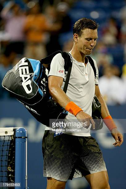 Tomas Berdych of Czech Republic walks off court after losing his men's singles fourth round match against Stanislas Wawrinka of Switzerland on Day...