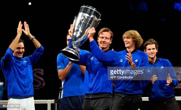 Tomas Berdych of Team Europe holds the trophy of Laver Cup on September 24 2017 in Prague / AFP PHOTO / Michal Cizek