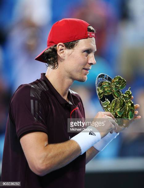 Tomas Berdych of the Czech Repblic poses after winning the final against Rafael Nadal of Spain during the Tie Break Tens ahead of the 2018 Australian...