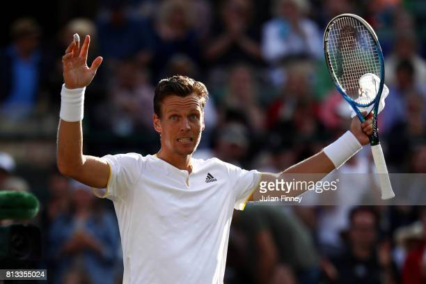 Tomas Berdych of The Czech Republic acknowledges the crowd after his Gentlemen's Singles quarter final match as opponent Novak Djokovic of Serbia...